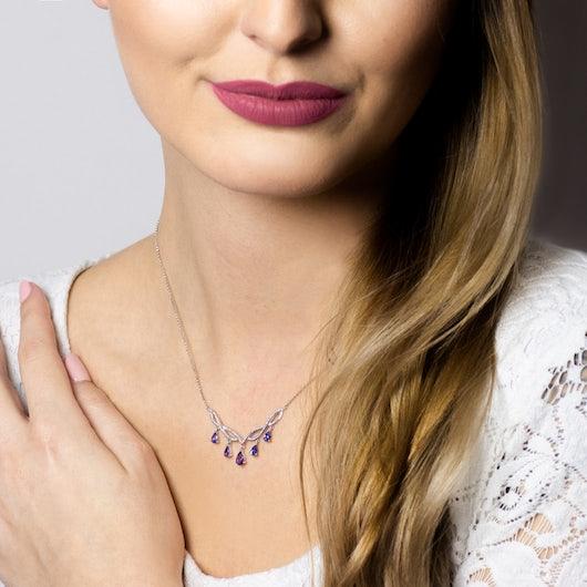 Kolia Savicki: białe złoto, tanzanity
