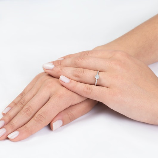 Side-Stone Engagement Ring: two colour gold, diamond